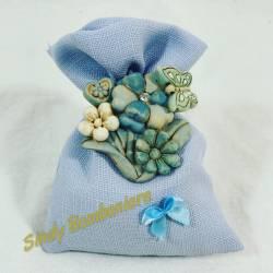 Sacchetto portaconfetti con applicazione floreale in resina bambino