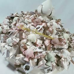 Bomboniera confezionata sacchetti in cotone con pumo in ceramica per cresima e comunione