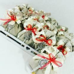 Cesto bomboniere originali per cresima 20 sacchettini pendente chiave simboli sacramento