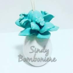 MARTA MARZOTTO bomboniera confezionata fiore loto CELESTE AMBIENTE EFFUSORE sopra mobile idea battesimo MATRIMONIO